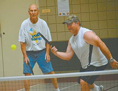 Kevin Keller, right and Russ Meyers play a tough game of pickleball on Wednesday at the Cottonwood Recreation Center. (Photo by Vyto Starinskas)
