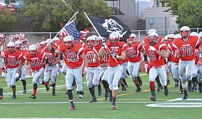 The Marauders take the field during their first game of the season against Cactus Shadows. On Friday, Mingus defeated Greenway by a total of 20-14. Alec Phyfer led the way for the Marauders carrying the ball 9 times for 121 yards.(Photo by Vyto Starinskas)