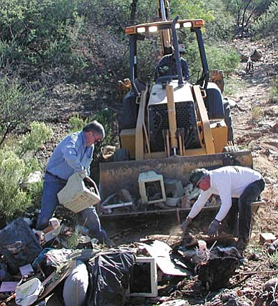 Massive forest land clean-ups used to be a monthly task for the Verde Valley's Stewards of Public Lands. The persistent work combined with a concerted effort to educate the community about the available options for getting rid of trash and debris has made the Stewards' work much easier today than when it was first established in 2004. (Photo courtesy of Diane Joens)