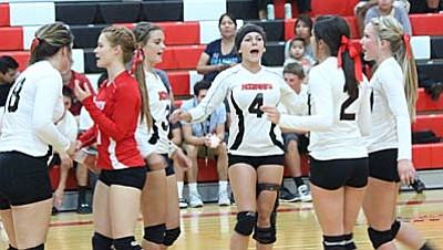The Mingus Volleyball team celebrates after gaining a point during their game against Tuba City earlier this season. The Marauders gained their first two victories this season beating Page and Mayer. (Photo by Greg Macafee)