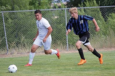 Nathan Schultz battles for possession of the ball with a Chino Valley defender earlier this year. Schultz scored the only goal  in the  Cowboys 2-1 victory over Show Low. (Photo by Greg Macafee)