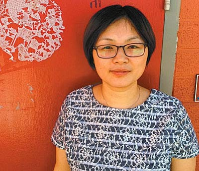 """English is comparatively easy because you only have 26 letters. But in Chinese, the most commonly-used characters, there are 3,000. Then you need to write names, so it's a much, much longer time to learn."" Ni Fen Fen, Mandarin Chinese instructor, Mingus Union High School. (VVN/Tom Tracey)"