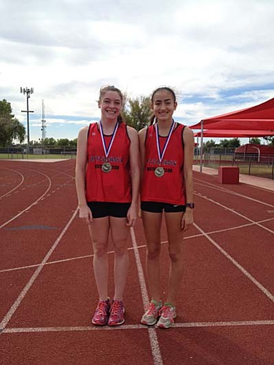 Penny Fenn (Left) and Allyson Arellano pose with their medals after the Mesa Thunderbird Cross Country Classic. (Photo By Micah Swenson)