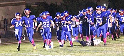 The Camp Verde Cowboys take the field Friday night for their game against the Paradise Honors Panthers. It was the last home game for the seniors on the football team. At halftime seniors Trevor Heyer, Jaysen Leonard, Dakota Brueland, Bryce Wantland, Thomas Herrera, Jordan May, Jesse Etienne, and Chandler Crittendon were honored for their dedication to the program. (Photo by Greg Macafee)