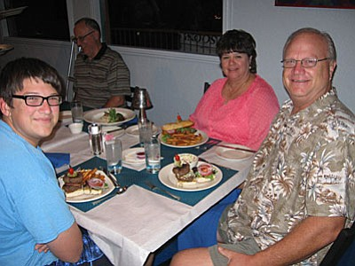From left: Mathew, Pastor Fred and Jenny Mast Karma Café; Caption 2: Cathy Spina, Owner of Karma Café of Sedona.
