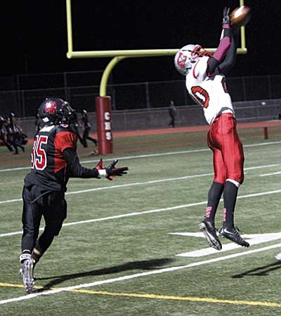 Mingus defensive back Anthony Accurso picks off a pass in the end zone against Coconino earlier this year. Accurso is second on the team in touchdowns on the ground this year with six. This was Accurso's only interception of the regular season. The Marauders have six players with one interception this year. (Photo by Greg Macafee)