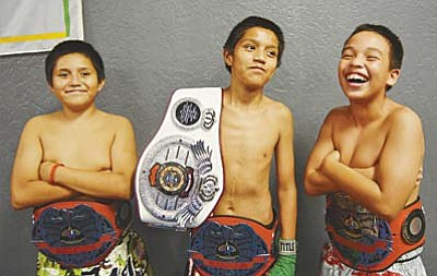 Larson's  Champ fighters  (L) Avery Hines, Adam Hines and Kainen Cummings share a moment at the boxing gym in Camp Verde. (Photo courtesy of Don Decker)