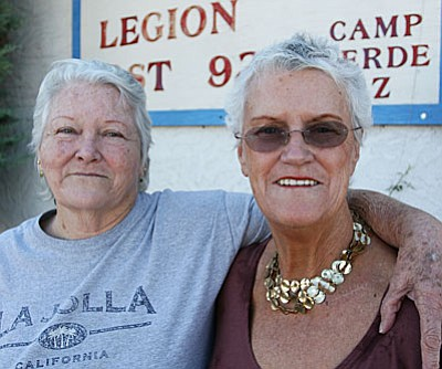 Sharon Doran, right, and Sharon Hollamon, show their commitment to their country as members of American Legion Post 93's auxiliary in Camp Verde. Doran is a charter member of the legion. (Photo by Bill Helm)