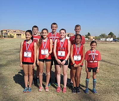 Pictured are the Aftershock Distance Running club runners who competed at the USATF State Meet at Friendship Park in Avondale. Allyson Arellano and Penny Fenn both won state titles at the meet. Front Row: Karen Arellano, Allyson Arellano, Penny Fenn, Destini Lobato, and Jenna Caccia. Back Row: Jacob Ulibarri, Jon Ulibarri, and Josh Reilly. (Courtesy Photo)