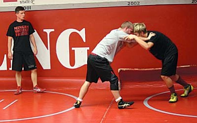 Mingus Mountain Wrestling Coach Klint Mckean gives direction to two wrestlers during a preseason camp earlier this year. The Mingus Mountain Wrestling team placed tied for 5th at the 24th annual Mingus Mountain Wrestling Tournament this weekend. (Photo by Greg Macafee)