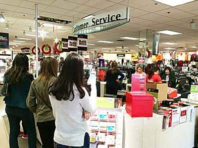 "Black Friday shoppers line-up at the checkout counter inside the JC Penney store in Cottonwood. Manager Lori South said ""We probably had one hundred people waiting in line when we opened Thanksgiving.""  VVN/Tom Tracey"