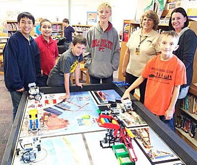 Mountain View Preparatory robotic team members Ashton Bialek-King, Anthony Rodriguez, Braden Reay, David Rutschow and Mark Rutschow, with teachers Fran Forester and Teresa Rose. (VVN/Tom Tracey)