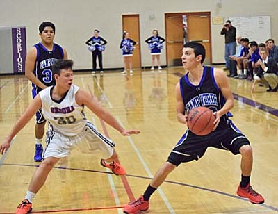 Camp Verde's Javier Perez steps back for a three during Thursday night's game against Sedona Red Rock. Perez finished with 28 for the Cowboys. (Photo by Greg Macafee)