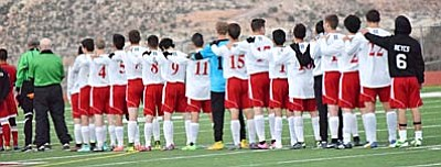 The Mingus Marauders boys soccer team lines up for the National Anthem earlier this season when they took on the Moon Valley Rockets. The Marauders have went 1-2 since their loss to Moon Valley back on December 15. (Photo by Greg Macafee)