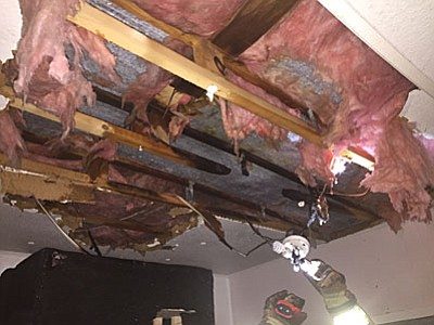Verde Valley Fire District crews were able to locate the origin of the fire in the void just above the ceiling, according to a news release from the fire district. The fire appeared to have started from electrical wiring there. (Photo courtesy of VVFD)