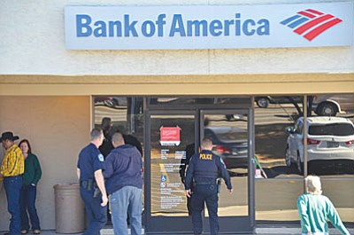 Approximately $350,000 was stolen during Wednesday's burglary of the Cottonwood Bank of America. It appears that the suspect may have had knowledge of banking procedures to include security procedures. Information has been obtained that a white sedan was seen in the area during the time of the initial alarm call at 1 a.m. (VVN/Vyto Starinskas)
