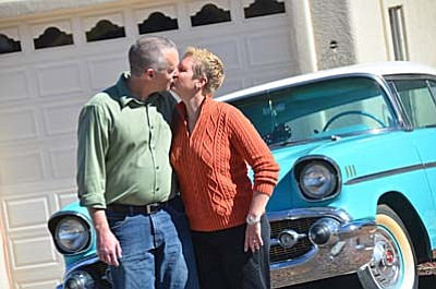 """Adam and Brenda Hansen stand with their '57 Chevy. """"This car was very significant to us, especially in the early days of our relationship,"""" Adam Hansen says. """"It was my first car and we went to all of our dances, junior and senior proms, and even used it in our wedding."""" (Photo by Vyto Starinskas)"""