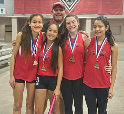 Micah Swenson (back) poses with his 4x800m relay team of (L to R) Allyson Arellano, Destini Lobato, Penny Fenn and Karen Arellano after they set the meet record at the Great Southwest Indoor Classic for the third-straight year. (Courtesy Photo)