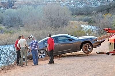 A towing company retrieves the stolen Dodge Charger from the Verde River late Friday afternoon. (VVN/Vyto Starinskas)