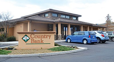 Pending approvals of bank regulatory agencies and stockholders of both institutions, Cottonwood's Country Bank will merge with Mohave State Bank and assume the Mohave name. (VVN/Vyto Starinskas)<br /><br /><!-- 1upcrlf2 -->