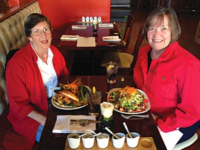 Carolyn Fisher and Carol Keefer enjoy delicious luncheon salads while visiting at the  Schoolhouse Restaurant