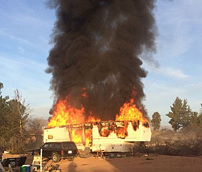 A fifth-wheel RV engulfed in flames during a Feb. 26 fire at 3130 Lost River Dr. in Camp Verde. (Photo courtesy Camp Verde Fire District)