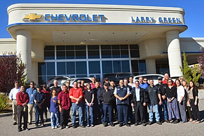 Employees pose in front of Larry Green Chevrolet on Rodeo Drive on Wednesday morning. VVN/Vyto Starinskas
