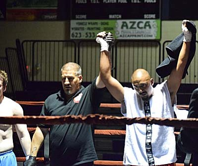 Jeese Gonzales gets his hand raised after his victory Saturday night. Gonzales earned his first victory in nearly three years. (Photo by Greg Macafee)