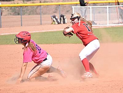 Freshman second baseman Ashley McCracken shows some nifty footwork around the bag in an attempt to turn a double play Friday afternoon. (Photo by Greg Macafee)