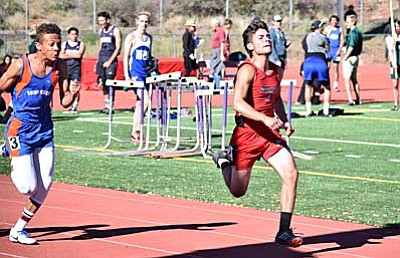 Fabian Navarro runs in the 100 meter dash Wednesday afternoon at Sedona Red Rock High School. Navarro ran a time of 12.06 seconds which earned him a 7th place finish. (Photo by Greg Macafee)