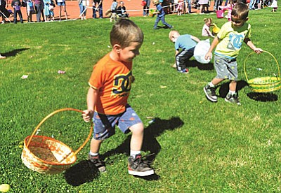 Riot Trujeque, 3 runs down Easter eggs and candy on the baseball field at Riverfront Park on Saturday morning during The City of Cottonwood Parks and Recreation Department's annual Easter-Egg Hunt. VVN/Vyto Starinskas