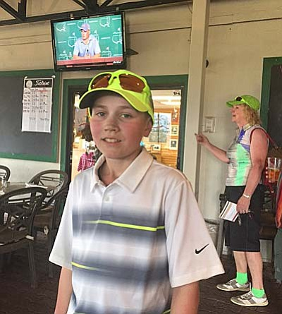 Cooper Neil poses for a photo after shooting a 73 at Verde Santa Fe, and acing hole No. 16. Neil, visiting his grandmother from Snoqualmie, Washington, said he's been playing golf since the age of one. (Courtesy Photo)