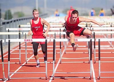 Mingus' Nick Lodico leads Jordan Pollock during the Yavapai County track meet at Bradshaw Mountain High School Friday afternoon. Lodico took seventh in the event with a clocking of 20.31. Photo by Les Stukenberg/The Daily Courier<br /><br /><!-- 1upcrlf2 -->