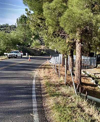 The Yavapai County Sheriff's Office reported the passenger was impaled by the top rail of a chain link fence at the crash site. It was estimated that at least 100-feet of fencing had been damaged. (Photos courtesy of YCSO)