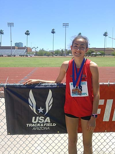 Allyson Arellano poses for a photo with her three medals from this past weekends USATF AZ State Meet at Mesa Community College. (Courtesy Photo)
