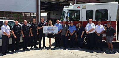 Pictured from left to right: City Manager- Doug Bartosh, Officer Tate Stearley, Sergeant Josh Fradette, Police Chief Steve Gesell, Sergeant Kevin Murie, Angela Harrolle (100 Club Director), Engineer Brandon Wacker, Jim Iacovacci, Fire Inspector Steve Trautman, Mayor Diane Joens, Fire Chief Mike Kuykendall, Fire Marshal Rick Contreras and JP Vicente (100 Club).