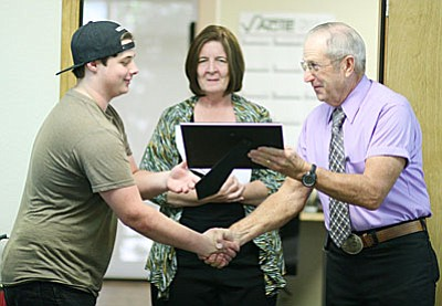 Valley Academy Career and Technology Education recently recognized Brian Porter, 2016 graduate of Mingus Union High School, for completing career and technology education programs in automotive technology, mechanical drafting and technical theatre. Also pictured, VACTE Program Manager Donna Green and board President Steve Dockray.