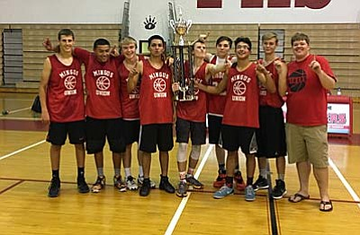 From Left to Right. Chaz Taylor, Miles Tapija, Jordan Pollock, Issac Escalante, Chase Paquin, Michael Bryan, Victor Anaya, Scottie Wilson, Head Coach David Beery, pose for a photo after winning the 24-team tournament in Florence over the weekend. (Courtesy Photo from Tandy Taylor)