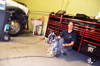 "Helaine Kurot with ""Turbo"" at her shop at 350 Automotive at 468 C South Main St. Suite C in Cottonwood."