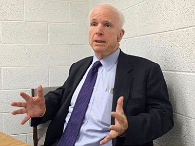 John McCain: The world is more dangerous than it's ever been since the end of WWII. Millions of refuges. ISIS all over the world. China aggressively active in the Pacific. Russia dismantling Ukraine. (VVN/Vyto Starinskas)