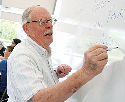 """As president of the Verde Valley Forum for Public Affairs, Dick Dahl, pictured at the Aug. 18 Future Leaders Forum at Yavapai College's Clarkdale campus, said that the forum process is """"all about seeking consensus from the broadest possible demographic representation of all stakeholders in the Verde Valley region."""" (Photo by Bill Helm)"""