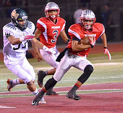 Mingus' Jose Pacheco runs for a big gain in the Marauders' convincing 42-10 win over Mohavea Friday. (VVN/Vyto Starinskas)