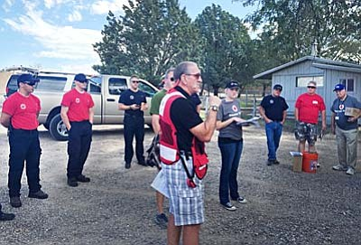 Volunteers from Copper Canyon Fire & Medical Authority and the Red Cross install 71 new smoke alarms to homes in the Verde Lakes neighborhood Saturday morning. (Courtesy Photo)