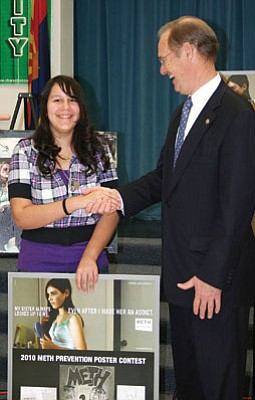 Submitted photo Alyssa Castillo, a seventh grade student at Williams Elementary-Middle School, is congratulated by Attorney General Terry Goddard. She was recognized for winning second place in the 2010 Meth Not Even Once Poster Contest. Castillo's artwork was incorporated into the poster.