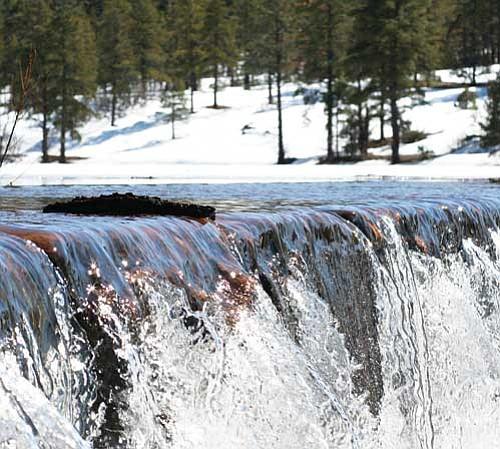 <br>Ryan Williams/WGCN<br> Water runs over Santa Fe Dam in early March.