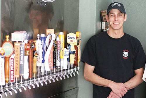 <br>Ryan Williams/WGCN<br> Jason Moore now serves 20 beers on tap at his newly expanded Twisters.