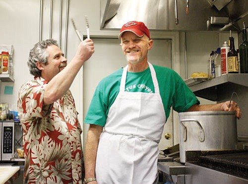 <br>Ryan Williams/WGCN<br> Northern Arizona Barbecue Festival organizers David Haines (left) and Chuck Vaughn hard at work in the kitchen preparing for the upcoming event July 3-4.