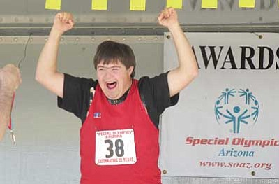 Submitted photo<br> Bryant Wiese celebrates after earning a silver medal in the 100-meter dash.