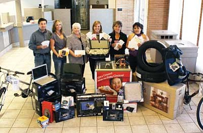 6ee7dcf138 Ryan Williams WGCN br  Parents Who Care committee members display prizes  available at