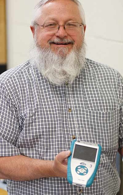 Ryan Williams/WGCN<br> Larry Gutshall displays a mobile data collecting device.